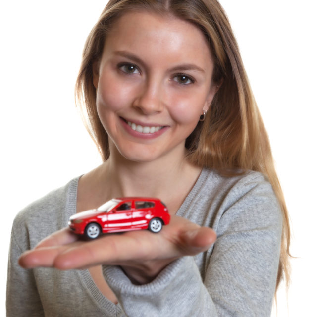 girl with car in hand