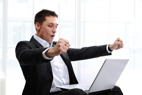 Person Excited at Computer
