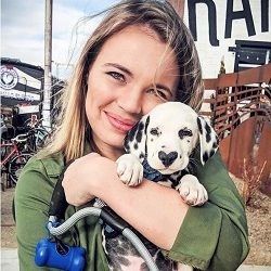 hugging a spotted puppy