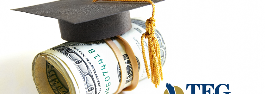 Roll of money with a graduation cap on.