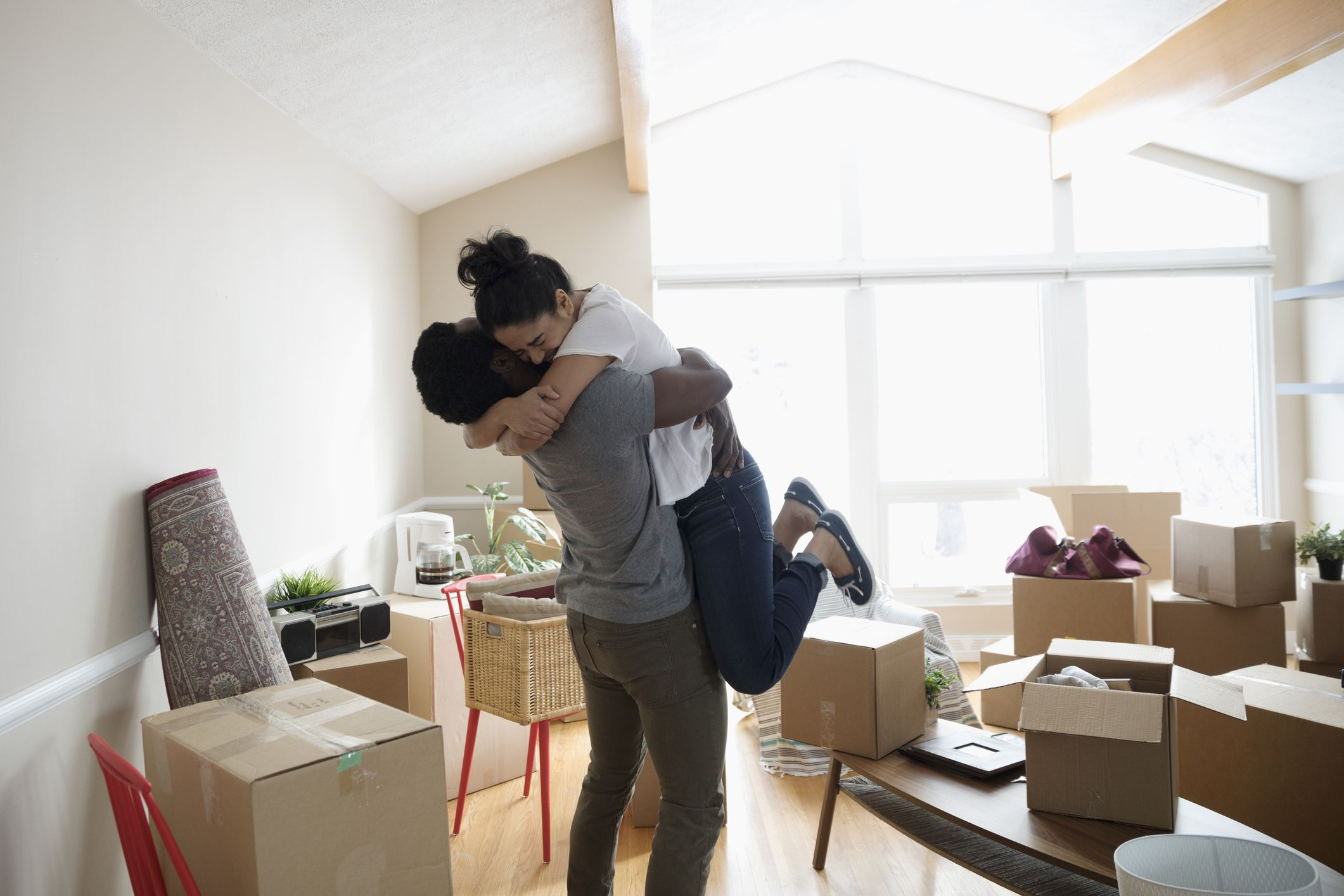 Happy Couple Hugging After Moving Into Their New Home