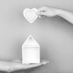 Hands Holding a House and a Heart