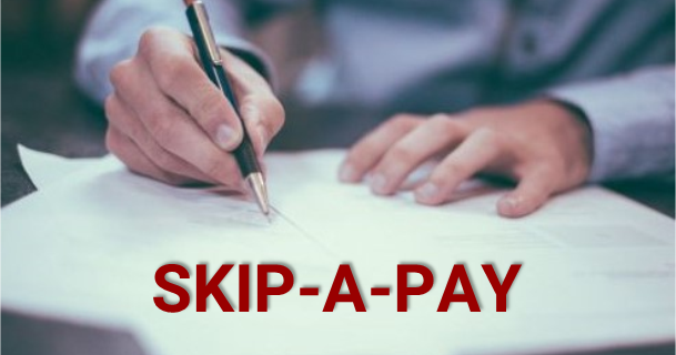 Man Writing on Papers Skip A Pay