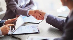 Business representatives shaking hands