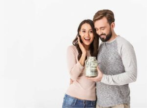 Man and woman happy with a jar full of money