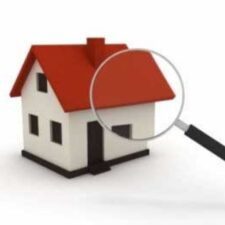 Magnifying glass on white house with red roof