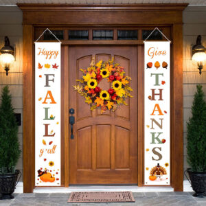 A brown front door of a home that has signs that say happy fall and give thanks
