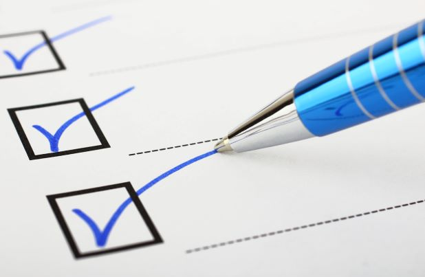 Checklist with Blue Pen
