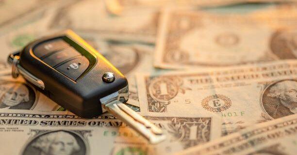 Car Key on top of dollar bils
