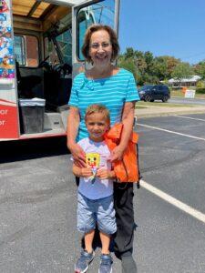 Commerce Branch Teller Janice and her grandson