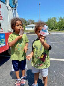 Two children enjoying their popsicles member appreciation day 1